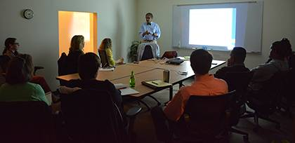 Benjamin Reese, center, vice president of the Office for Institutional Equity, leads a workshop in Smith Warehouse about unconcious bias.