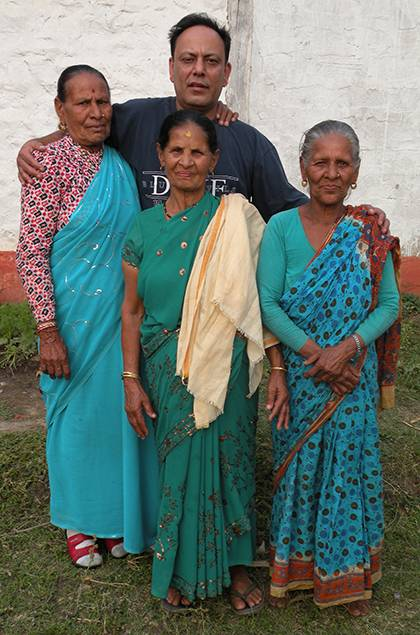 Kisan Upadhaya, back row, was reunited in 2012 with his family in India, including (from left) his mother, his step-mother, and his great aunt. Photo courtesy of Kisan Upadhaya.