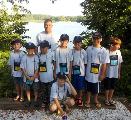 Sgt. Mark Faust poses with a group of boys he worked with during his week at the Concerns of Police Survivors summer camp, where children of police officers killed in the line of duty gather to cope with the grief of losing a parent. Photo courtesy of Ma