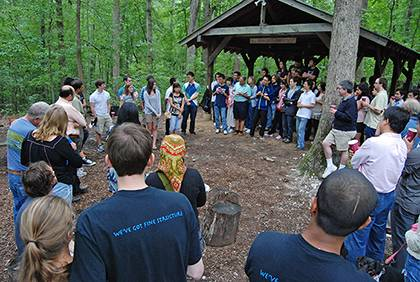 Faculty, staff and graduate students from the Department of Physics gather for their annual picnic at a picnic area in Duke Forest. Photo by Marsha A. Green.