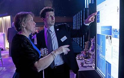 William Conescu, right, former director of Duke development communications, explores the Duke Forward website with Alice McKenzie at the Duke Forward campus launch. Photo by Duke Photography.