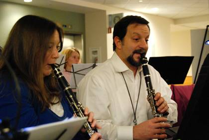 Physician Nick Bandarenko, right, and administrative assistant Angela Bloemeke, left, are enthusiastic members of the Duke Medicine Orchestra. Photo by Marsha A. Green