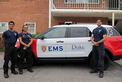 Junior Krishan Sivaraj, left, and seniors Britany Thompson and Jay Srinivasan post by Duke EMS' new response vehicle. Volunteers with Duke EMS provide first-response support for emergencies across campus. Photo by Bryan Roth.