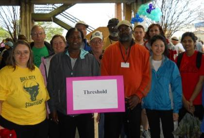 Betsy Johnson, at left in second row wearing a pink jacket, prepares to walk the Great Human Race with Threshold members. Photo courtesy of Threshold.