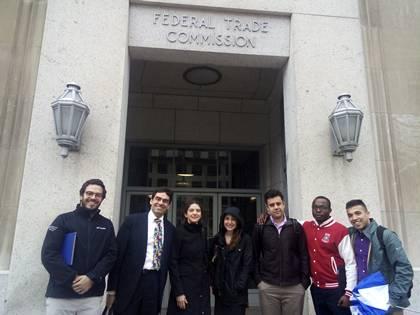 Student Max Fischer-Zernin, professor Tim Büthe, professor Umut Aydin, and students Rachel Glanz, Raffi Garnighian, Marquese Robinson and Nikhil Gavai at the entrance to the Federal Trade Commission in Washington, DC.