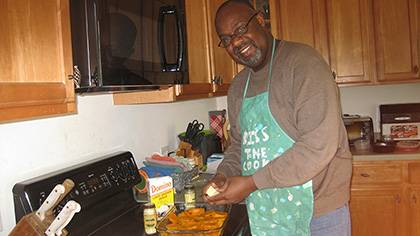 Kerry Haynie loves to cook and bake traditional family dishes like cream cheese pound cake and German chocolate cake, a few favorite desserts. Here, he's making a sweet potato casserole. Courtesy of Kerry Haynie
