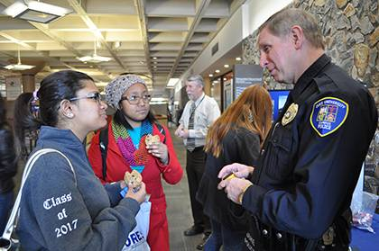 Eric Hester, right, chats with students during Duke Police's last