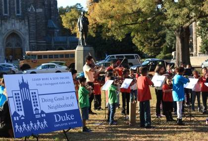Elementary students in KidZNotes perform classical music at Duke in October as part of the Doing Good in the Neighborhood campaign. KidZNotes is a local organization supported by the campaign. Photo courtesy of the Office of Durham and Regional Affairs.