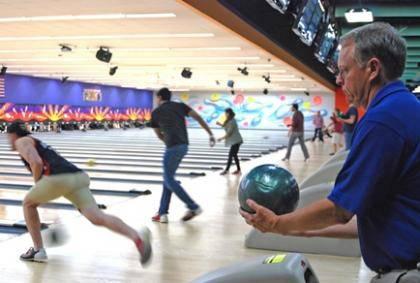 Law Professor Tom Metzloff helped launch Duke Law School's bowling league a decade ago. Photo by Marsha A. Green.