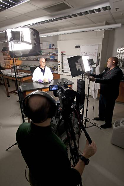 Leonard White, associate professor in the Duke Institute for Brain Sciences, films a lecture for his Medical Neuroscience class, available through Coursera. Behind the camera is Kennard Blake, videographer/editor for University Center Activities & Events