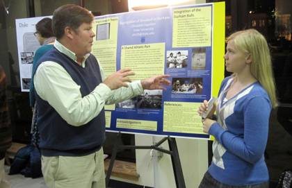 Duke student Elizabeth Hazelton speaks with neighborhood activist John Schelp about her research on the historic segregation of baseball in Durham. Photo by Cindy Gardiner