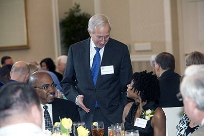 President Richard H. Brodhead chats with LaMonica Hunter, a Meritorious Service Award winner, at the Presidential Award Luncheon in 2012. Photo by Duke Photography.