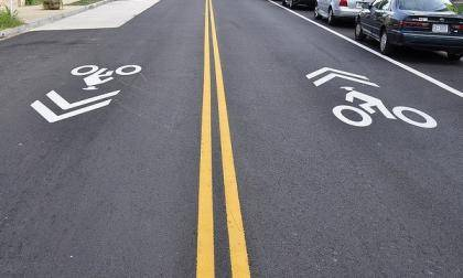 Duke is adding sharrows - symbols that alert drivers to share the road with bicyclists - to campus roads. Photo by Eric Gililland via Flickr.