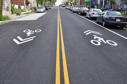 Many Duke roads feature sharrows - symbols that alert drivers to share the road with bicyclists. Photo by Eric Gililland via Flickr.