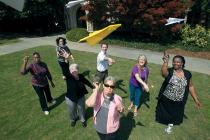 Divinity staff members take a moment to decompress with a paper airplane contest. Photo by University Photography.