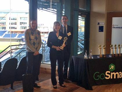 """From left, Parking and Transportation staff Matt Lardie, Alison Carpenter and Carl DePinto accept the """"Employer Commute Champion"""" award at GoSmart's Golden Modes ceremony. Photo courtesy of Alison Carpenter."""