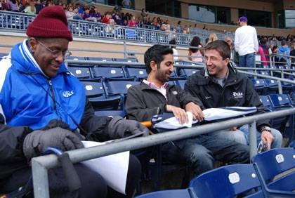 Ben Ward, left, at a Durham Bulls game with students Neil Krishnan and Christopher Tweed-Kent. Photo by Marsha A. Green.