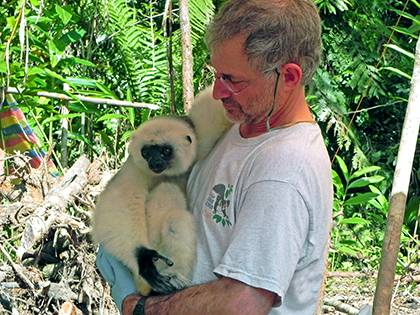 Bobby Schopler, staff veterinarian for the Duke Lemur Center, with a silky sifaka, one of the highly endangered species of lemur. Photo courtesy of Bobby Schopler.