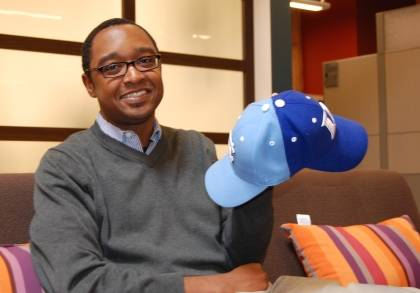 Jay Green displays the special, reversible hat created for him by his father-in-law to celebrate Green's dual allegiance to Duke and UNC-Chapel Hill.