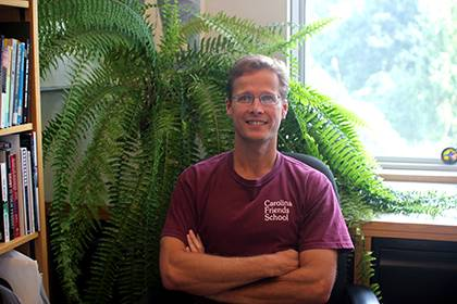 Joel Meyer with the fern in his office which has been propagated from a plant that has been in the family at least from the time of his grandmother, and perhaps longer. Photo courtesy of Joel Meyer.