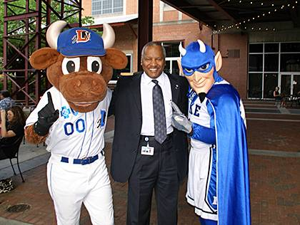 Phail Wynn with mascots from his two favorite places. Photo courtesy of Phail Wynn.