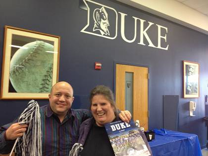 Lesley Looper, head of Duke Libraries' Receipts Management Section, poses in the Finch-Yeager Building for a picture with her boyfriend, George Weinstein, after Duke hosted University of Miami to end its regular season. Looper is attending the Belk Bowl