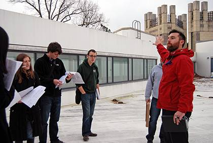 Casey Collins, energy engineer with Duke Facilities Management, leads a class of graduate students while discussing energy planning and use on campus. He and Steve Palumbo, also with Facilities, are co-teaching the class this semester. Photo by Bryan Rot
