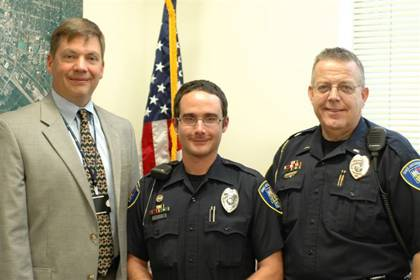 Ryan LaDuke, center, an officer with Duke Police, recently received recognition from John Daily, left, Duke Police chief, and Lt. Marshall Thompson, right, for his work with the Crisis Intervention Training program. (Photo courtesy of James Bjurstrom)