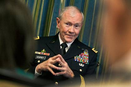 Gen. Martin Dempsey meets with the media Saturday. Photo by Chris Hildreth/Duke University Photography