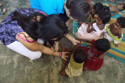 Derek Scott and Sonam Aidasani work with children of migrant workers at the Aksharavani school.  Photo by Rachel White.