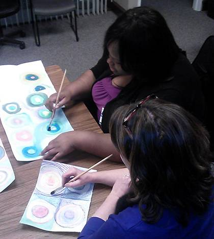 Members of the Mood Disorders Support and Education Group paint pictures as part of a group session. It's one way participants learn to deal with problems. Photo courtesy of Cynthia Jones.