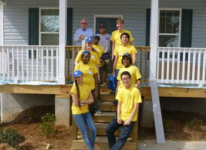 Dive Into Durham students volunteer at Habitat for Humanity this past Thursday.  Photo by Neil Hoefs.