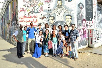 Mbaye Lo, left, with DukeEngage students this past summer in Cairo.