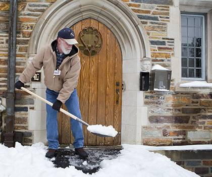 Frank Horner, residential life maintenance supervisor, shovels snow after intense snowfall last week. He was one of thousands of Duke employees to pitch in to keep the university and health system running. Photo by Duke Photography.