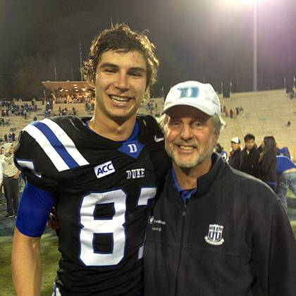 Dr. Anthony Galanos, Duke's honorary employee captain for the Aug. 30 football game, poses with Blue Devils wide receiver Max McCaffrey after a home game. Galanos wanted a picture with him because McCaffrey wears #87, the same number Galanos wore for his