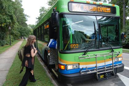 Orla Swift, left, boards Triangle Transit's Durham-Raleigh Express bus. Swift is among about 5,000 Duke community members who use a free GoPass to ride area buses.