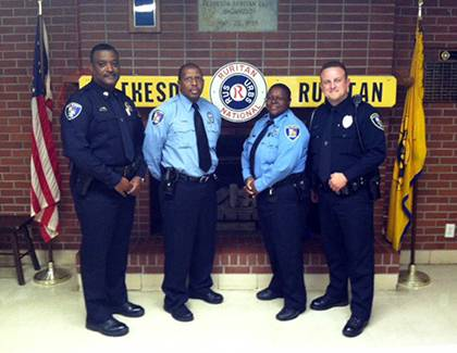 Duke Police Capt. Michael Linton, left, poses with officers Randall Jackson, Deonte Kennedy and Kelly George. All three participated in training as part of Duke's Crisis Intervention Team, a program that provides local first responders with training in