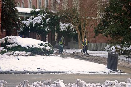 Facilities Management staff clear sidewalks on East Campus after last week's snowfall. In all, crews from the university and health system racked up almost 3,000 work hours to keep campus safe. Photo courtesy of Facilities Management.