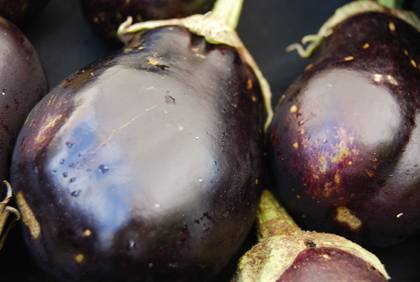 Eggplant is just one of many types of produce shoppers can find at the Duke Farmers Market. Photo by Bryan Roth.