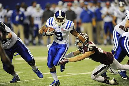 Duke running back Josh Snead breaks a tackle during the Blue Devil's appearance in the Chick-fil-A Bowl in December. Employees can catch Snead and other players in 2014 for a deeply discounted ticket price. Photo courtesy of Duke Athlietcs.