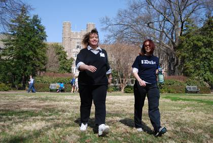 Debbie Edenton, left, and LaDonna Lindstedt, right, go for a walk on Duke's West Campus Quad. The pair is using the Get Moving Challenge as a way to prepare for kidney transplant surgery. Photo by Bryan Roth.