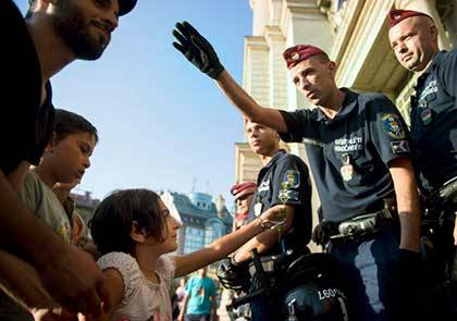 Refugees face Hungarian security officials. Photo by Aladár Madarász, Institute of Economics, Hungarian Academy of Science