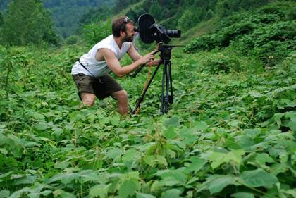 Duke filmmaker Josh Gibson among the kudzu, the subject of one of his recent films. Photo Courtesy Josh Gibson