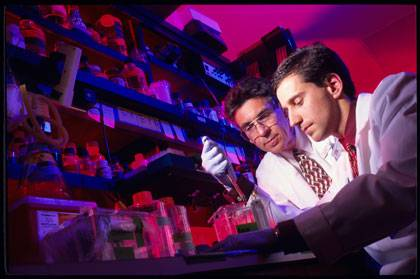 Robert Lefkowitz, left, with a student in his lab.  Lefkowitz has mentored around 220 grad students and postdocs.  Photo by Duke University Photography