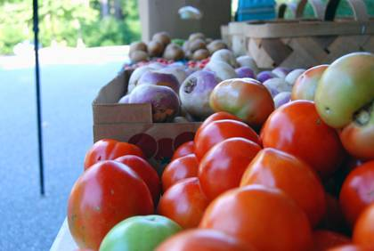 Farmers are currently offering a variety of fall fruits and vegetables like tomatoes, potatoes and more. Photo by Bryan Roth