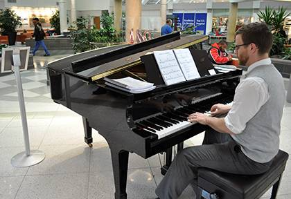 William Dawson, an artist in residence for Arts & Health at Duke, plays piano in the Duke Hospital lobby on Thursdays. Photo by April Dudash
