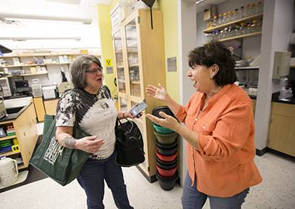 Joanne Bisson, right, assistant to Paul Modrich, celebrates with Elisabeth Penland, a research technician in Modrich's lab, after they learned that he was awarded the Nobel Prize in Chemistry early this mor