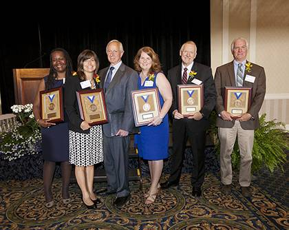 The 2012 Presidential Award winners gathered with President Brodhead after the award luncheon. From left: Cynthia P. Chavious, Julia A. Woodson, President Richard H. Brodhead, Susan L. Bonifield, Jonathan Giles and Paul D. Jones. Photo by Duke Photograph