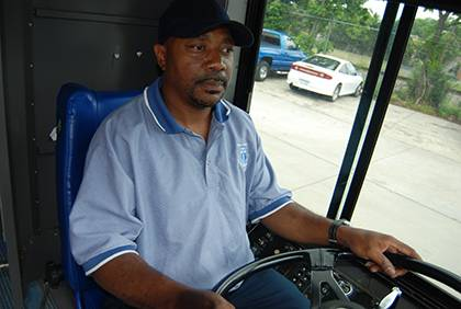 Jonathan Perry, a bus driver with Parking and Transportation Services, readies to leave on his route. This summer, Perry is driving the H6 bus route for Duke Transit. Photo by Bryan Roth.
