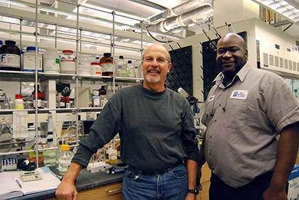 Bob Mook, left, received help from Rodney Terrell when vials of anti-cancer drug research went missing. Terrell helped Mook recover years of work and research. Photo by Bryan Roth.